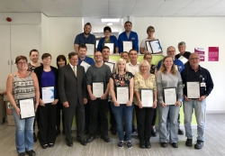 Oxley team members receiving certificates for completing qualifications and training